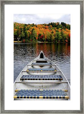 Canoe On A Lake Framed Print by Oleksiy Maksymenko