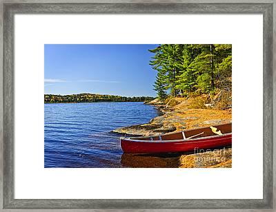 Canoe On Shore Framed Print