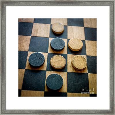 Checkers On A Checkerboard Framed Print