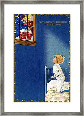 Child Watches As Santa Comes Down Chimney On Christmas Eve Framed Print by American School