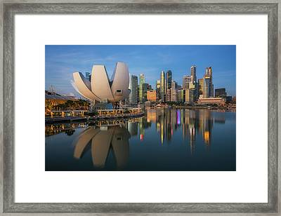 Cityscape Of Singapore City Framed Print by Anek Suwannaphoom