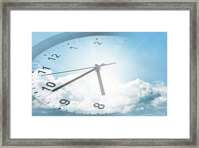 Clock In Sky Framed Print by Les Cunliffe