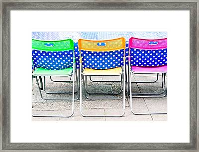Colorful Chairs Framed Print by Tom Gowanlock