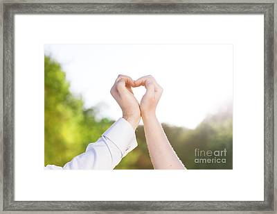 Couple In Love Making A Heart Shape With Their Hands Outdoors Framed Print by Michal Bednarek