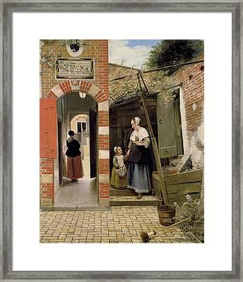 Courtyard Of A House In Delft Framed Print by Pieter de Hooch