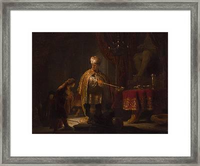 Daniel And Cyrus Before The Idol Bel Framed Print by Rembrandt van Rijn