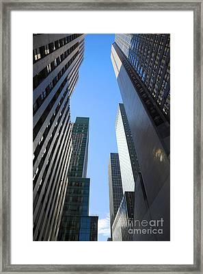 Dark Manhattan Skyscrapers Framed Print by Jannis Werner