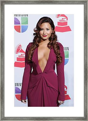 Demi Lovato Wearing A Roland Mouret Framed Print by Everett