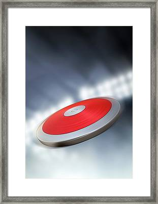 Discus In Night Stadium Framed Print