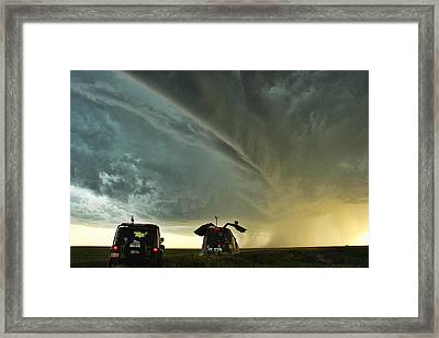 Dominating The Storm Framed Print by Ryan Crouse