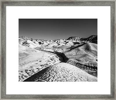 Framed Print featuring the photograph Elephant Knees And Mud Hills by Alexander Kunz