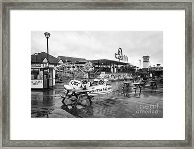 Empty Outdoor Amusement Park On A Cold Wet British Summer Day North Wales Uk Framed Print by Joe Fox