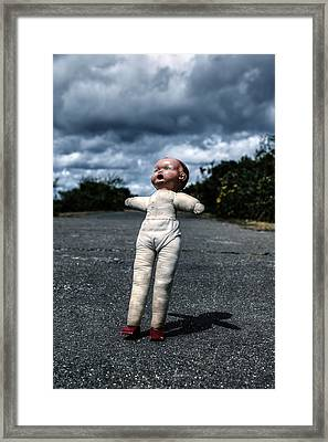 Falling Doll Framed Print
