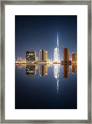 Fascinating Reflection Of Tallest Skyscrapers In Business Bay District During Calm Night. Dubai, United Arab Emirates. Framed Print