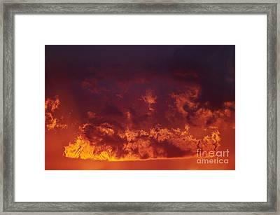 Fiery Clouds Framed Print by Michal Boubin