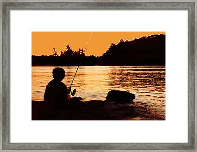 Fishing From A Rock  Framed Print