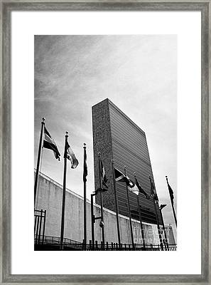 flags flying outside the UN secretariat tower building united nations New York City USA Framed Print