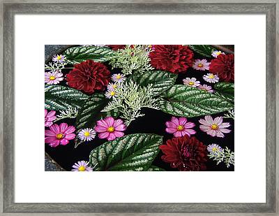 Framed Print featuring the photograph Floating Flower Bouquet by Byron Varvarigos