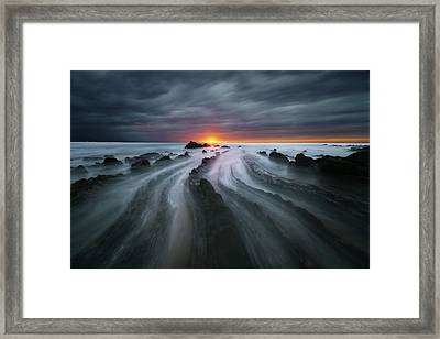 Flysch Rocks In Barrika Beach At Sunset Framed Print by Mikel Martinez de Osaba