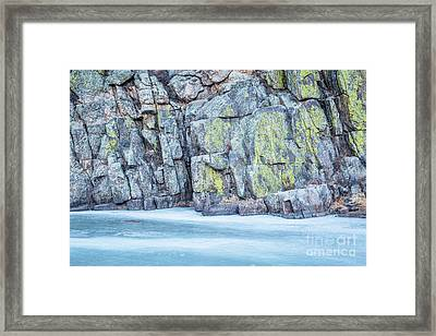 Frozen River And Rocky Cliff Framed Print