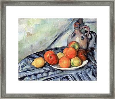 Fruit And A Jug On A Table Framed Print by Paul Cezanne