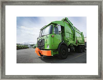 Garbage Truck Parked In A Parking Lot Framed Print by Don Mason