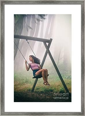 Girl In Swing Framed Print by Carlos Caetano