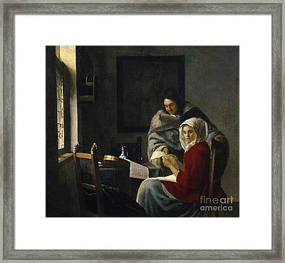 Girl Interrupted At Her Music Framed Print by Jan Vermeer