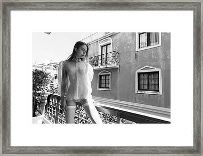 Girl On Balcony Framed Print