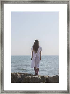 Girl On Cliffs Framed Print by Joana Kruse