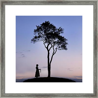 Girl With Lantern Framed Print