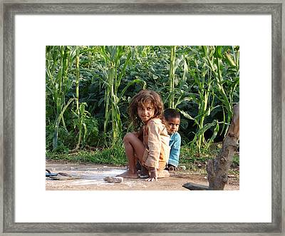 Girls In Her Own Field With Her Younger Brother Framed Print by Sandeep Khanwalkar