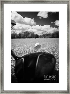 Golf Ball On The Tee With Driver Framed Print