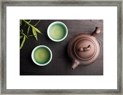 Green Tea In The Tea Cups Framed Print by Vadim Goodwill