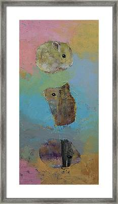 Three Little Hamsters Framed Print by Michael Creese