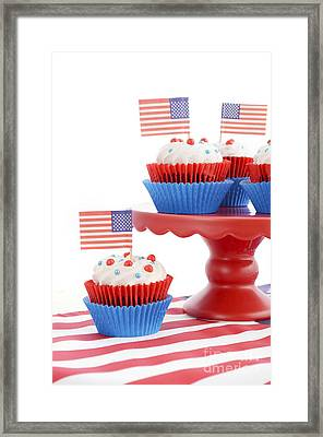 Happy Fourth Of July Cupcakes On Red Stand Framed Print by Milleflore Images