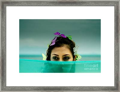 Hiding Framed Print by Michelle Meenawong