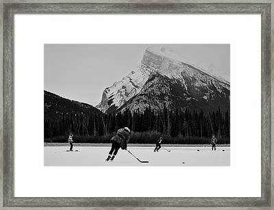 Hockey Under The Mountains Framed Print by Priscilla Westra