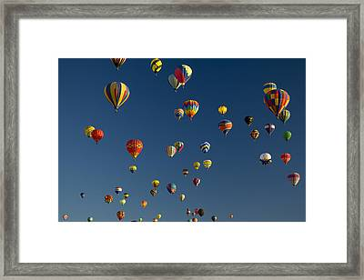 Hot Air Balloons Fly In A Hot Air Framed Print by Ralph Lee Hopkins