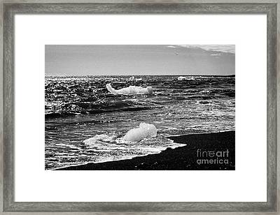 Icebergs Washing Up On Black Sand Beach At Jokulsarlon Iceland Framed Print