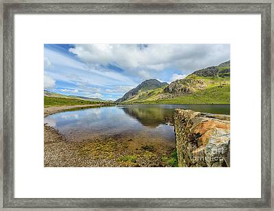 Framed Print featuring the photograph Idwal Lake Snowdonia by Adrian Evans