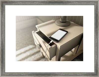 Illuminated Cellphone Next To Bed Framed Print by Allan Swart
