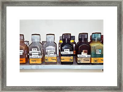 Laboratory Chemicals Framed Print by Tom Gowanlock