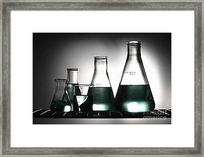Laboratory Glassware In Science Research Lab Framed Print by Olivier Le Queinec