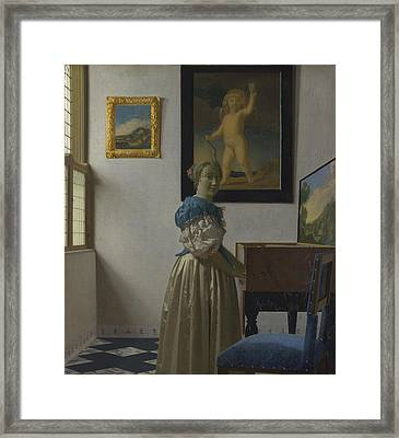Lady Standing At A Virginal Framed Print by Johannes Vermeer