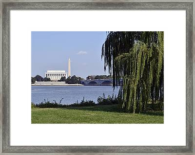 Lincoln Memorial And Washington Monument From The Potomac River Framed Print by Brendan Reals
