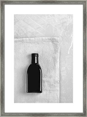Framed Print featuring the photograph Little Black Bottle  by Andrey  Godyaykin