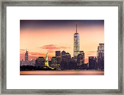 Lower Manhattan And The Statue Of Liberty At Sunrise Framed Print