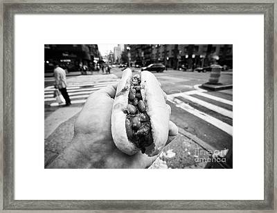 man holding chilli hot dog street food in New York City USA Framed Print