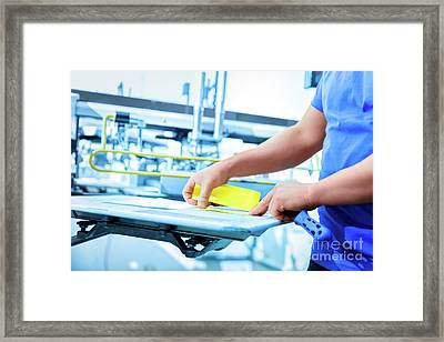 Man Preparing Fabric For Screen Printing. Framed Print by Michal Bednarek